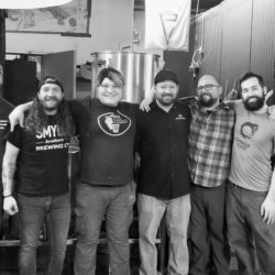 A group photo of some of the brewers that worked on All Together Now