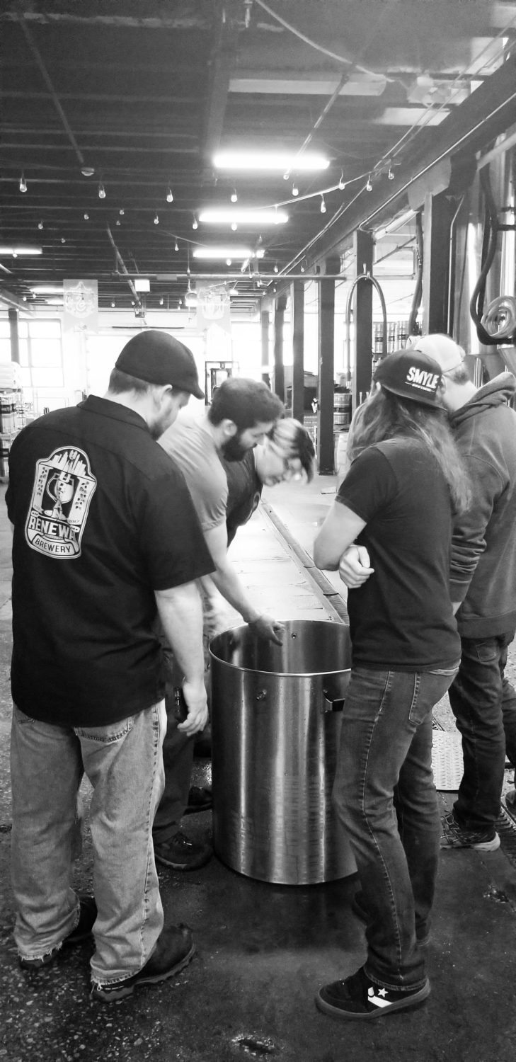 A group of Malt Row brewers brewing All Together Now
