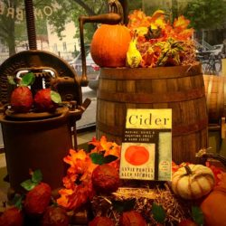 A collection of Cider Day supplies like recipe books, apples and more