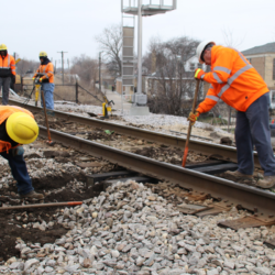 A picture of Metra construction crews working on tracks