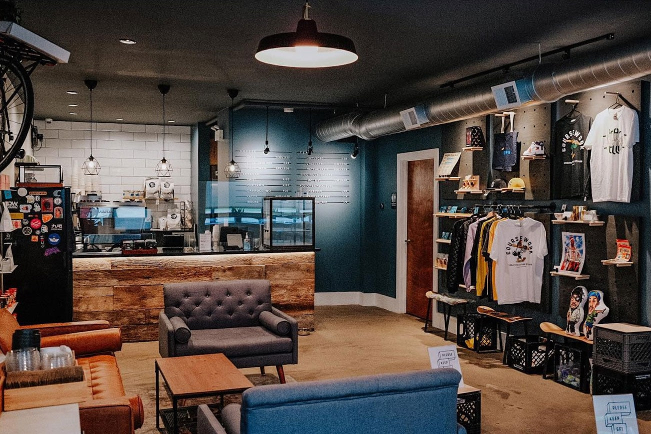 A photo of the cozy couches and interior of Side Practice Coffee