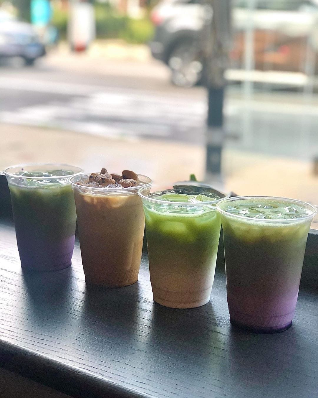 A picture of several colorful lattes