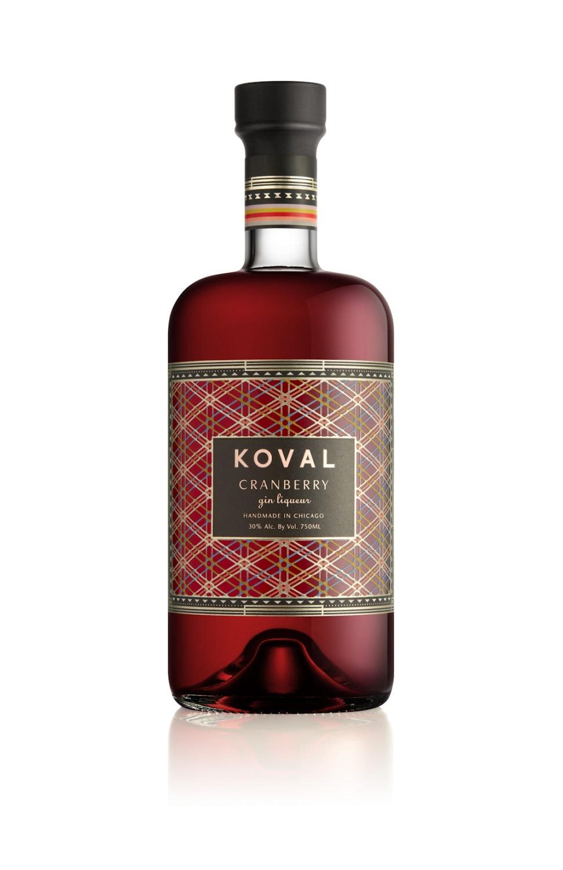 A bottle of KOVAL Distillery Cranberry Gin