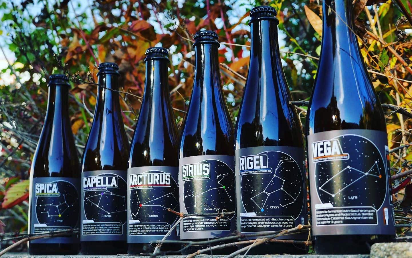 A photo of six bottles of wine barrel aged beers from Empirical Brewery