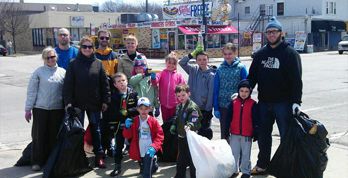 A group of Lincoln Square North Neighbors volunteers celebrate a fall cleanup in 2013