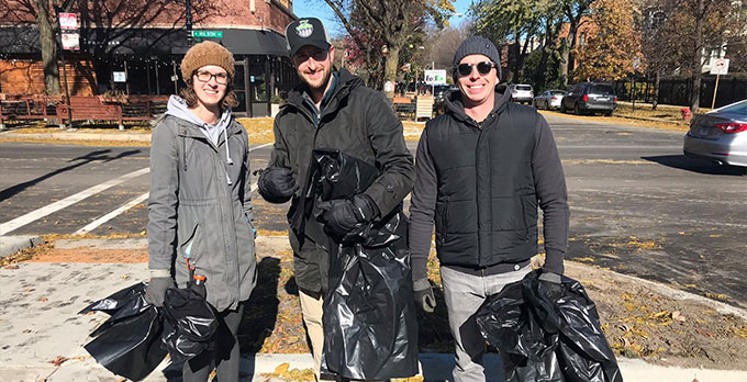 Ravenswood Neighbors Association volunteers pose in the middle of a 2018 year-end neighborhood cleanup