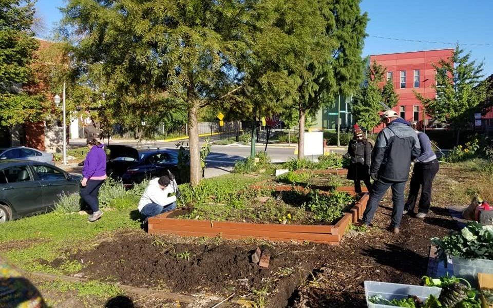 Volunteers work in the Bowmanville Gateway Garden