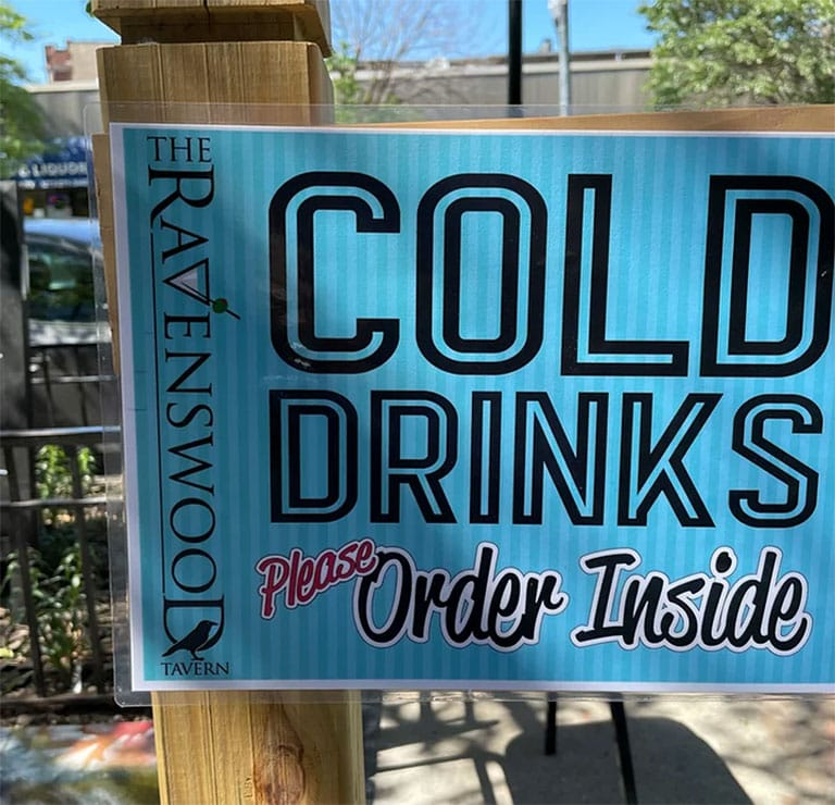 A picture advising customers to order cold drinks inside, even if they're outside on this dog friendly patio in Ravenswood