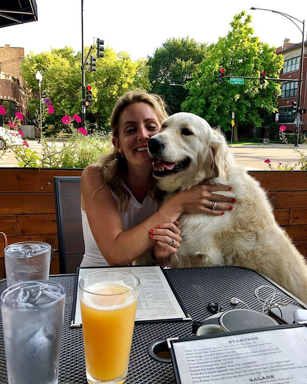 A dog and owner enjoy the patio at Wolcott Tap in Ravenswood