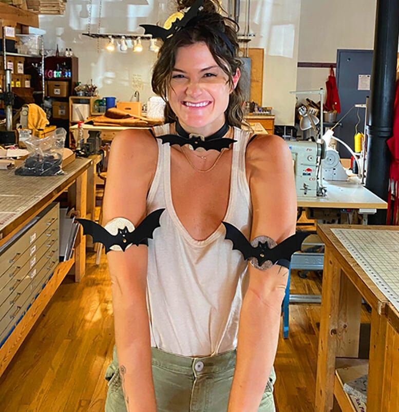 A student at the Chicago School of Shoemaking and Leather Arts  in Ravenswood, showing off their bat-themed apparel